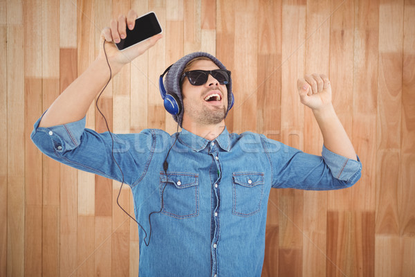 Hipster wearing sunglasses enjoying music Stock photo © wavebreak_media