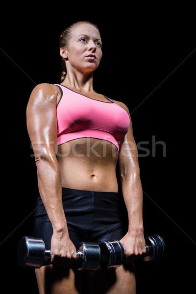 мнение женщину гантели черный Сток-фото © wavebreak_media
