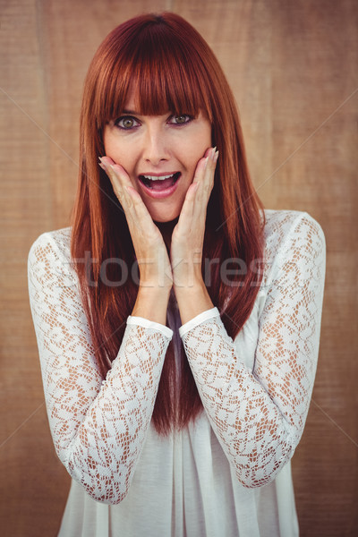Surprised hipster woman posing face to the camera Stock photo © wavebreak_media