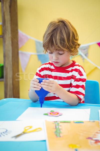 Small boy using a bottle of glue Stock photo © wavebreak_media