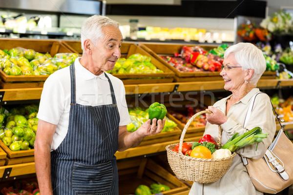Senior customer and worker discussing vegetables Stock photo © wavebreak_media