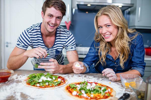 笑みを浮かべて カップル ピザ キッチン 女性 男 ストックフォト © wavebreak_media