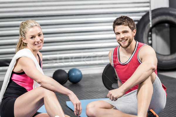 Couple sitting on fitness mat Stock photo © wavebreak_media