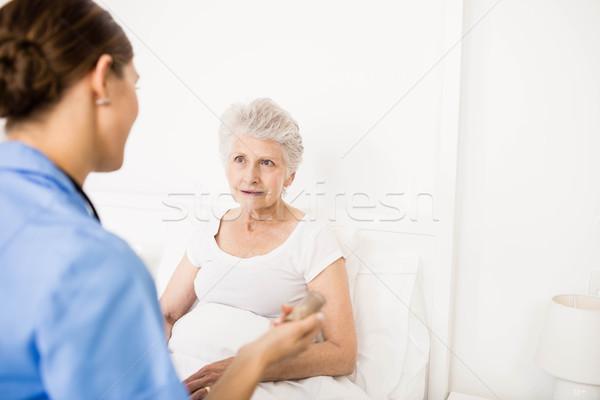 Nurse taking care of suffering senior patient  Stock photo © wavebreak_media