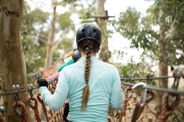 женщину ходьбе веревку моста вид сзади человека Сток-фото © wavebreak_media