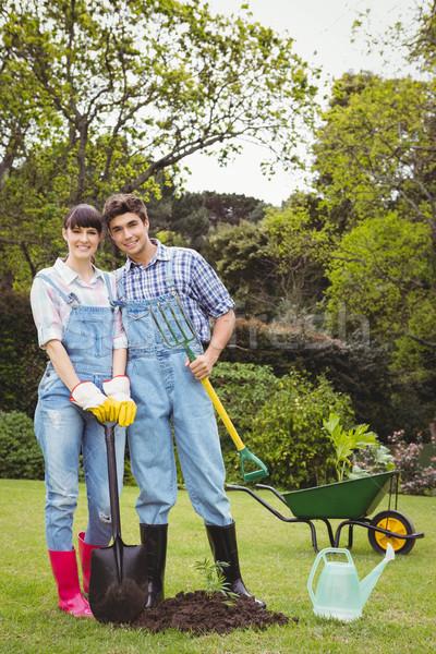Young couple holding shovel and spading fork Stock photo © wavebreak_media