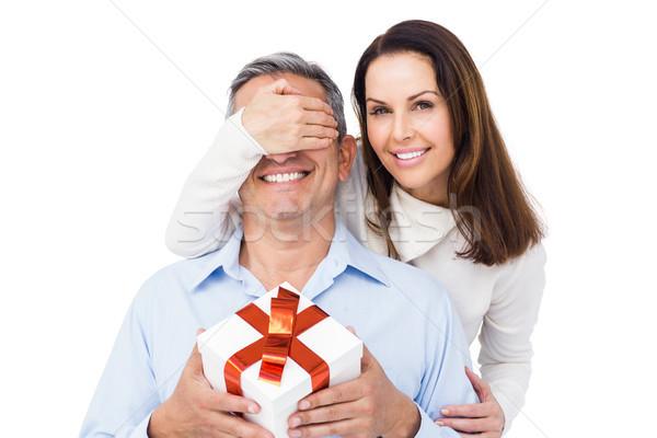 Pretty couple offering present to husband Stock photo © wavebreak_media