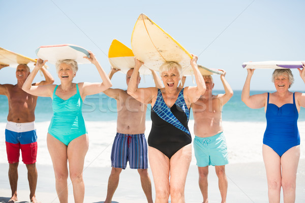Seniors holding surfboards at the beach Stock photo © wavebreak_media