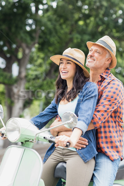 Stock photo: Happy woman riding moped with man