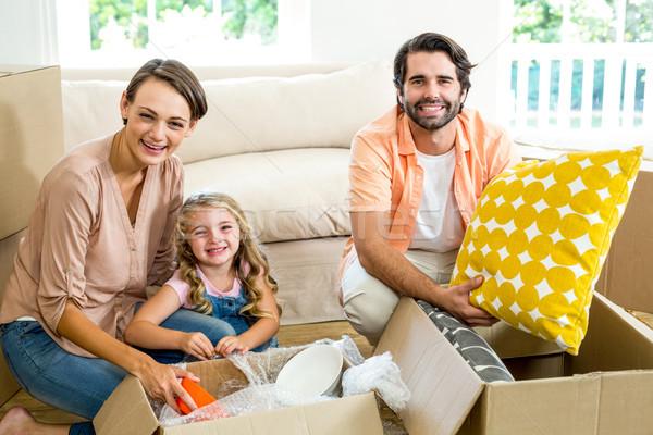 Happy family unpacking boxes in new house Stock photo © wavebreak_media