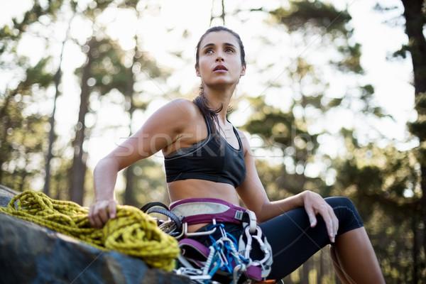 Woman sitting with climbing equipment  Stock photo © wavebreak_media