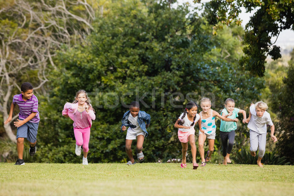 Kids playing together during a sunny day Stock photo © wavebreak_media