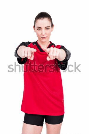 Female athlete posing with elbow pad and pointing the camera Stock photo © wavebreak_media