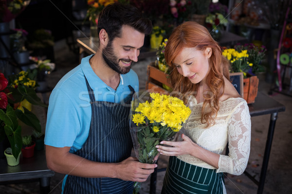 Couple holding flower bouquet Stock photo © wavebreak_media