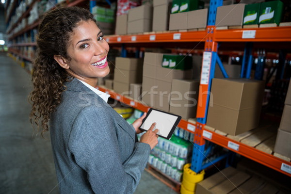 Business woman using her tablet Stock photo © wavebreak_media