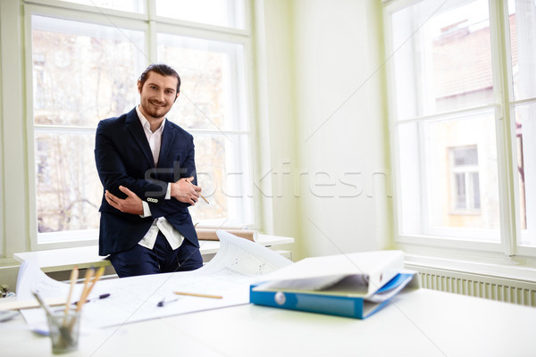 Smiling architect with arms crossed  Stock photo © wavebreak_media