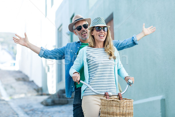 Mature couple riding bicycle by building Stock photo © wavebreak_media