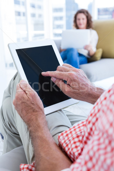 Midsection of man touching tablet at home Stock photo © wavebreak_media