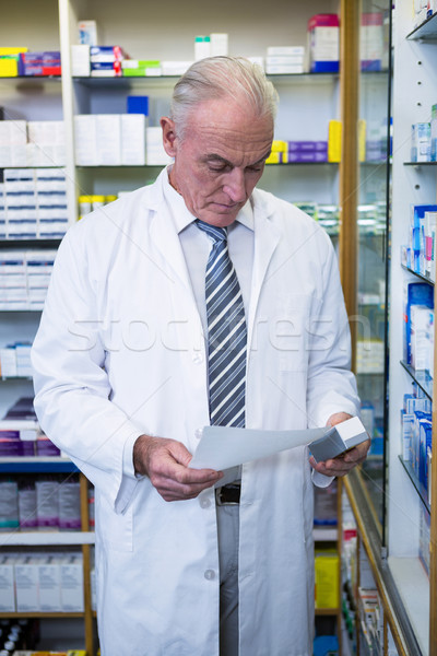 Pharmacist holding a prescription and medicine Stock photo © wavebreak_media