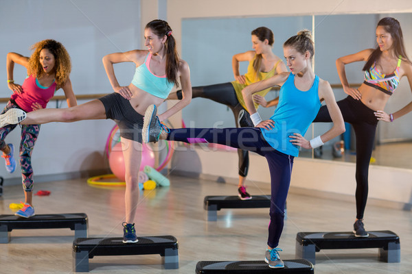 Group of women exercising on aerobic stepper Stock photo © wavebreak_media