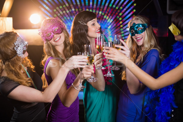 Group of friends toasting glass of champagne Stock photo © wavebreak_media