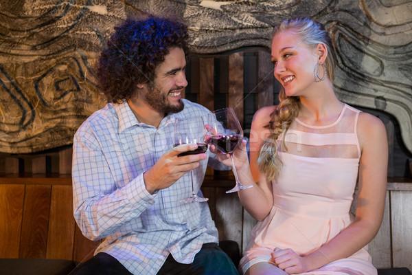 Couple toasting glass of wine in bar Stock photo © wavebreak_media