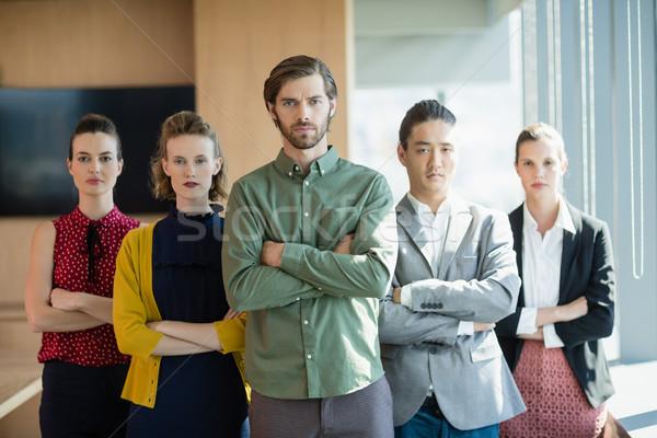 üzlet cégvezetők keresztbe tett kar áll iroda portré Stock fotó © wavebreak_media