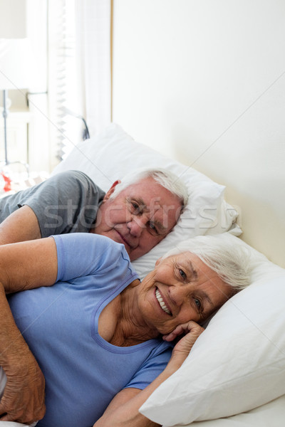 Senior couple relaxing in the bedroom Stock photo © wavebreak_media