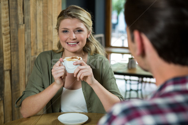 Smiling woman having coffee with man in cafe Stock photo © wavebreak_media
