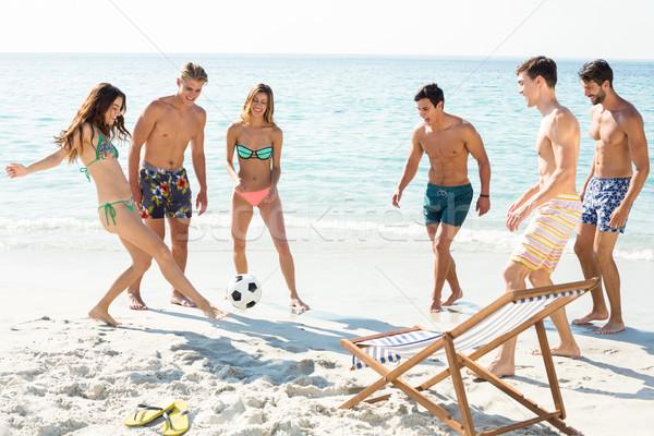 Mutlu arkadaşlar oynama futbol kıyı plaj Stok fotoğraf © wavebreak_media
