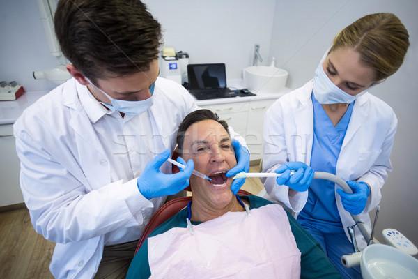 Dentistas anestesia masculino paciente homem feminino Foto stock © wavebreak_media