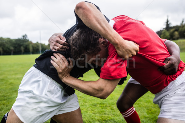Stock photo: Rugby players doing a scrum