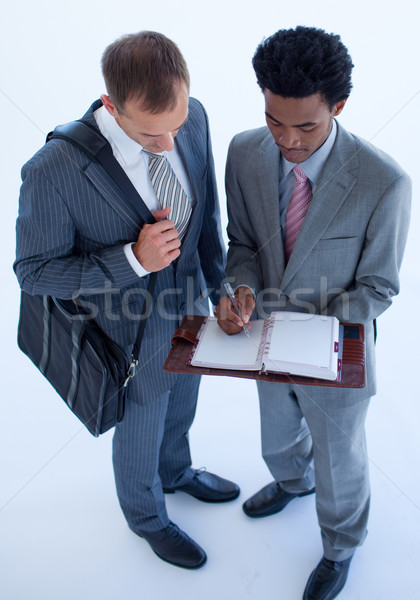 Businessmen writing in a business diary Stock photo © wavebreak_media