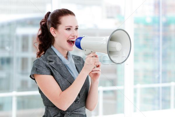 Self-assured businesswoman yelling through a megaphone Stock photo © wavebreak_media