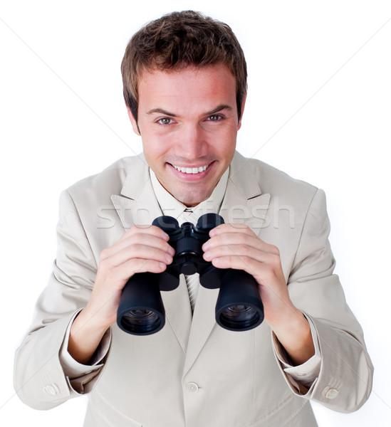 Alegre empresario mirando binoculares aislado blanco Foto stock © wavebreak_media