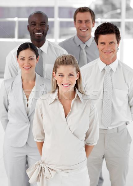 Cinco pessoas olhando câmera sorridente homens Foto stock © wavebreak_media