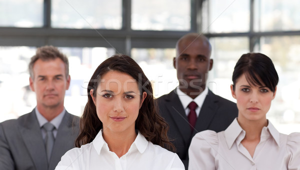 Jonge business team permanente samen glimlachend camera Stockfoto © wavebreak_media