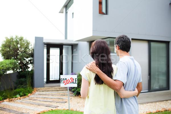 Newlyweds with their new house Stock photo © wavebreak_media