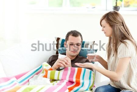 Woman taking care of her husband Stock photo © wavebreak_media