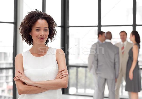 Afro femme d'affaires bras pliées collègues femme Photo stock © wavebreak_media