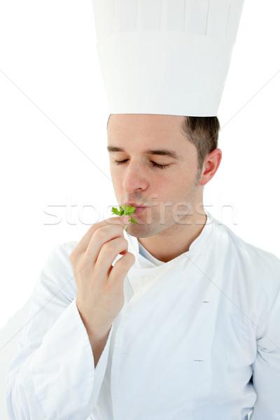 Jeunes Cook dégustation herbe blanche Photo stock © wavebreak_media