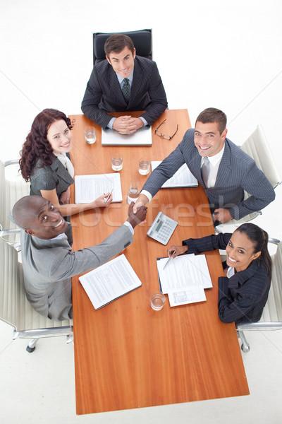 Empresarios apretón de manos reunión más personas Foto stock © wavebreak_media