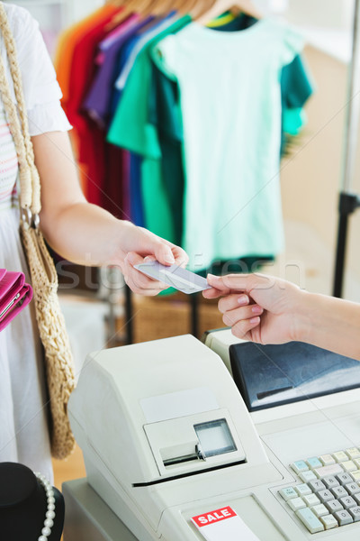 Close-up of a cute woman paying with her credit card in a shop Stock photo © wavebreak_media
