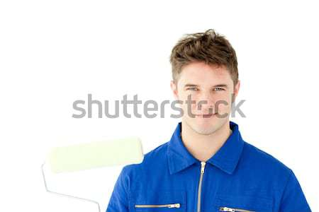 Good-looking male worker smiling at the camera against white background Stock photo © wavebreak_media