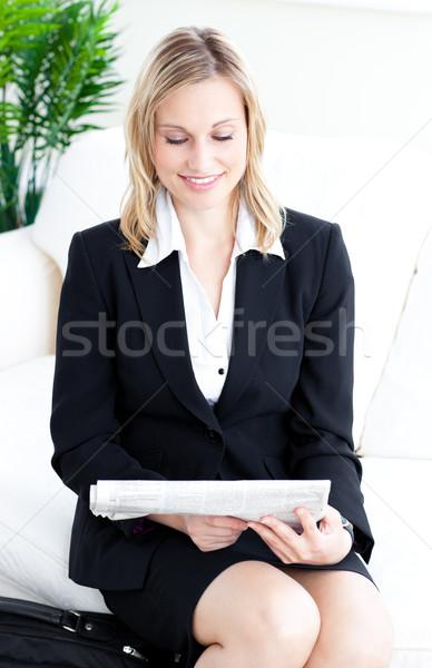 Assertive blond businesswoman reading the newspaper on a sofa Stock photo © wavebreak_media