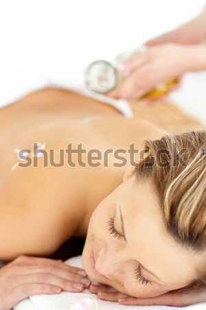 Glad young woman enjoying a back massage with oil in a spa center Stock photo © wavebreak_media