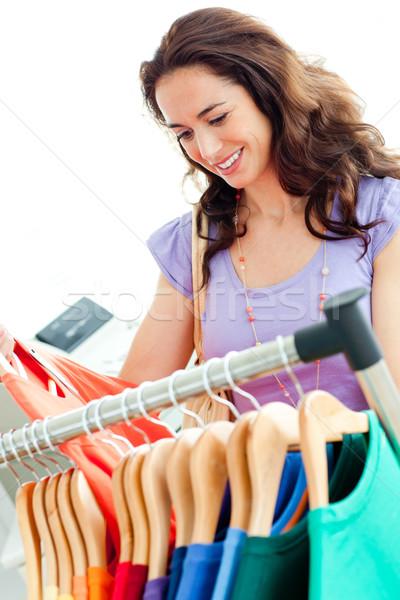 Caucasian woman selecting items in a clothes shop Stock photo © wavebreak_media