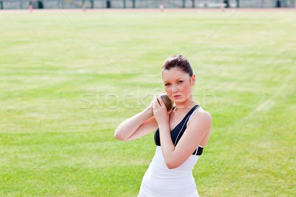 Determined female athlete holding weight Stock photo © wavebreak_media
