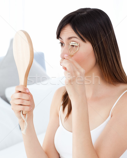 Woman curling her eyelashes Stock photo © wavebreak_media