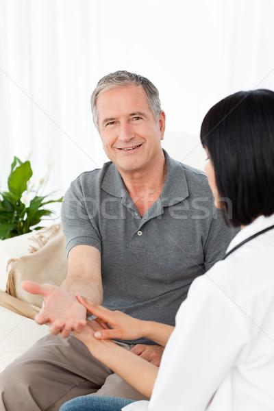 Enfermeira pulso paciente medicina ajudar Foto stock © wavebreak_media